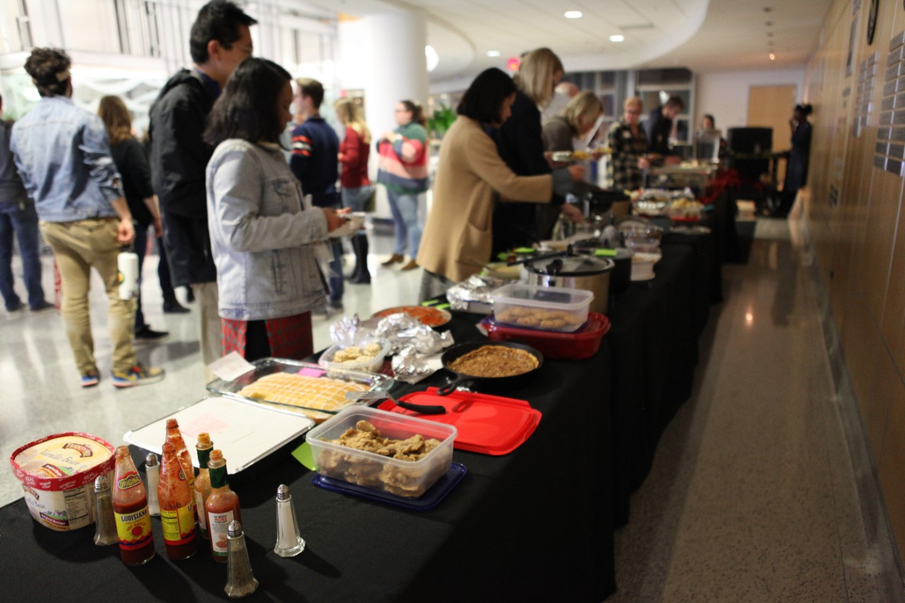 Attendees enjoy a delicious meal at the annual A&GS Multicultural Fest. Handmade dishes from all over the world were shared by our students, faculty, staff, and friends.
