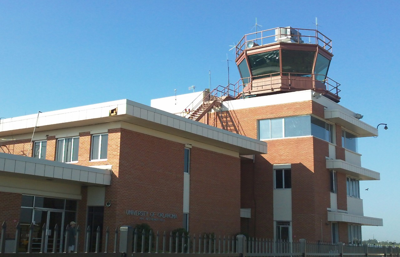 Max Westheimer Airport terminal building from ramp side with control tower