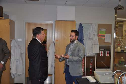 Assistant Professor, Adam Duerfeldt, speaks with the Congressman
