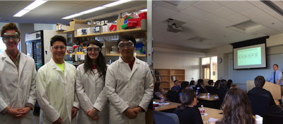 students posing in lab coats in classroom