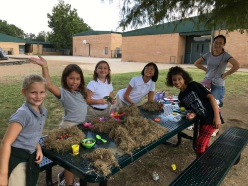 Children at picnic table making crafts