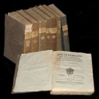 Photograph of 8 volumes of the Encyclopedie Methodique with one volume laying open