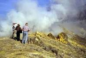 Vulcano 1995;Photograph of 3 people standing atop a smoking volcano