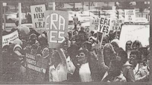 Crowd of protesters holding signs in support of ERA