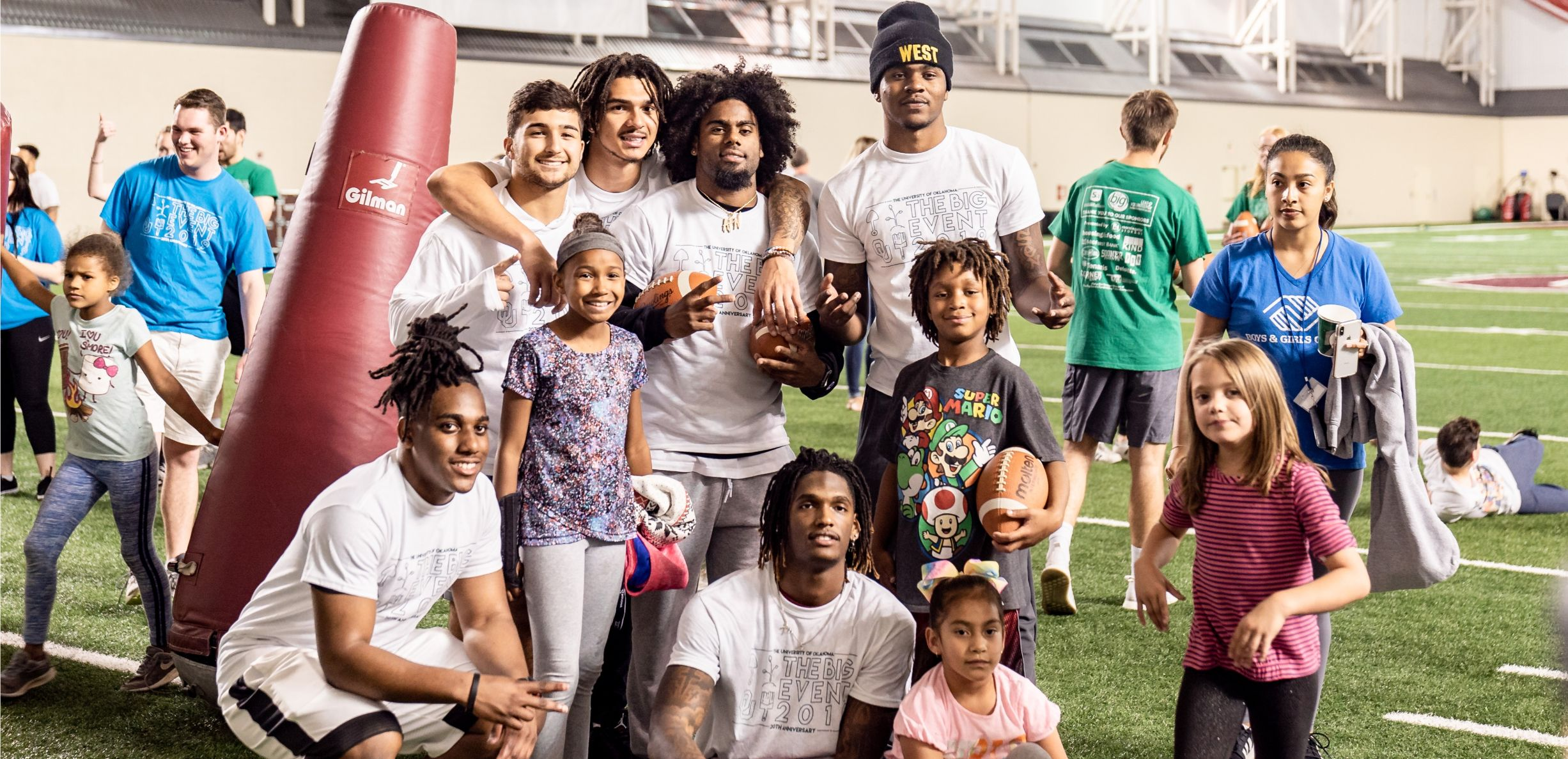 Football players and children pausing for a photo during The Football Event