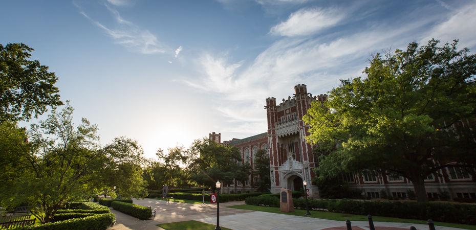 View of Bizzell Library with the sunset in the distance