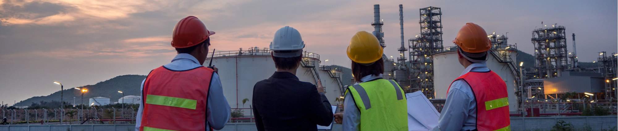 engineers looking at natural gas site together
