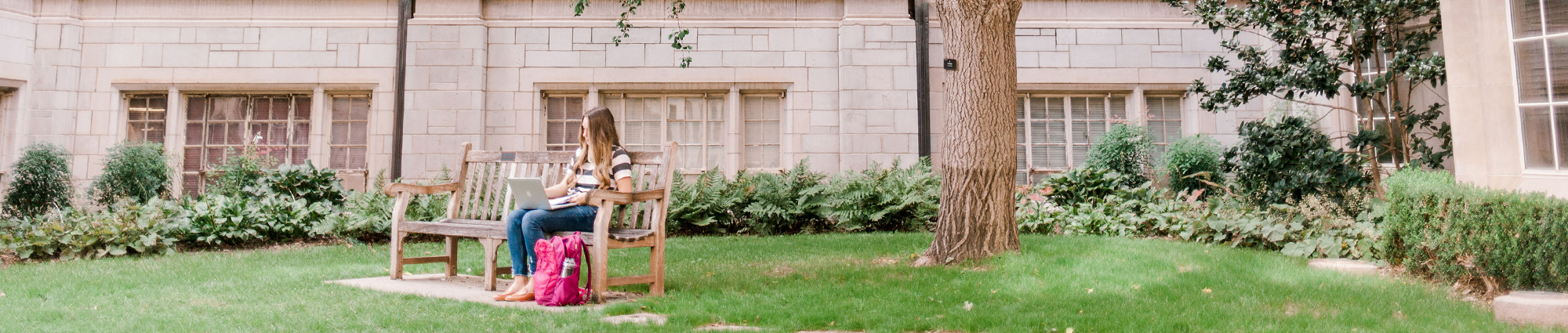 Student Sitting Outside Adams Hall