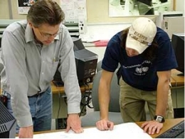 professor teaching a student during a technical production course