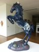 mustang up on hind legs, statue, glowing red eyes, fiberglass