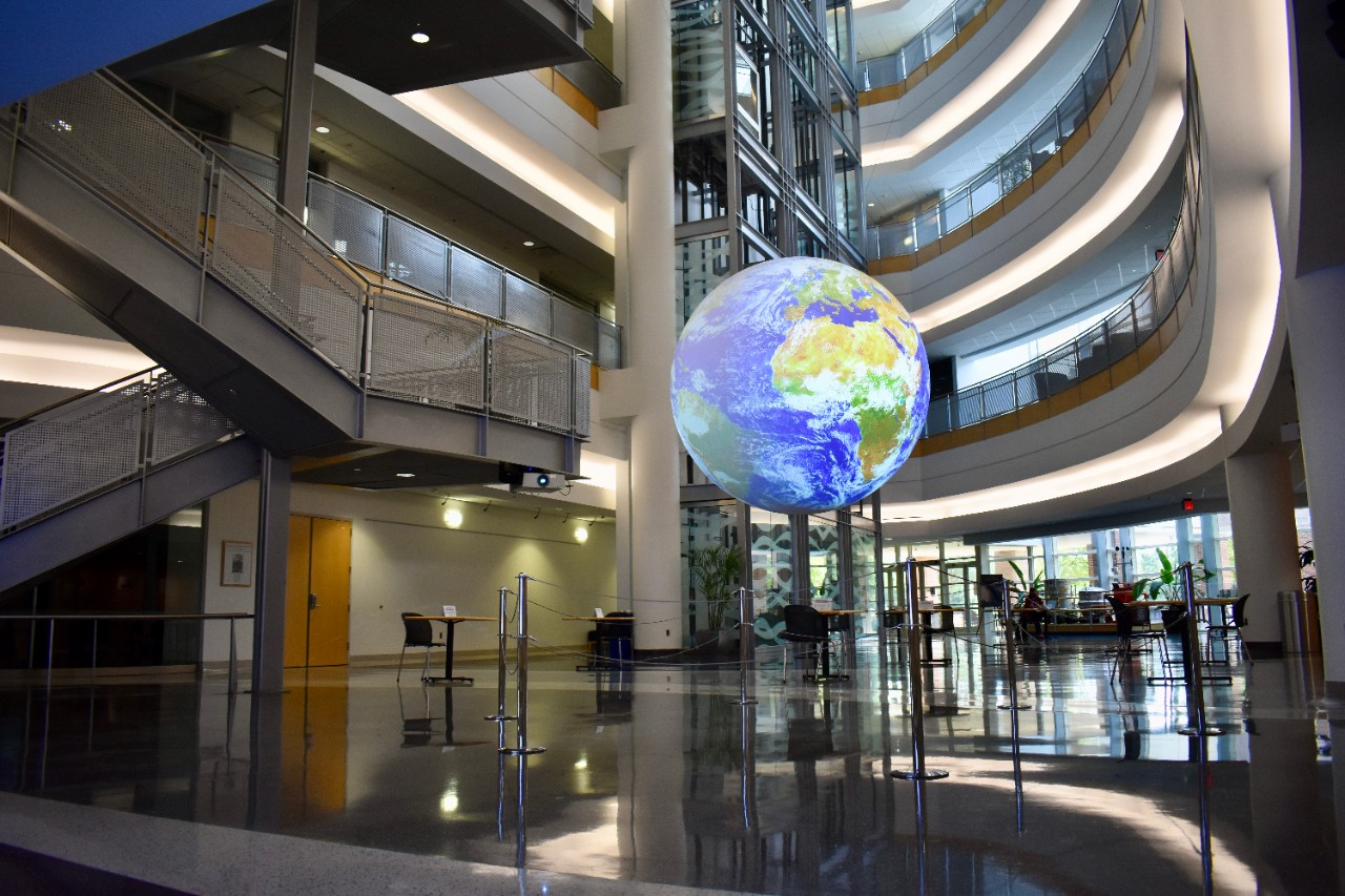 National Weather Center Atrium in 2020, featuring Science on a Sphere.