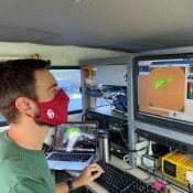 Graduate student Addison Alford operates the radar within the mobile radar truck. OU.