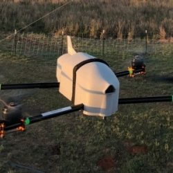 A CASS quadcopter drone, the Coptersonde 2, flies in a field.