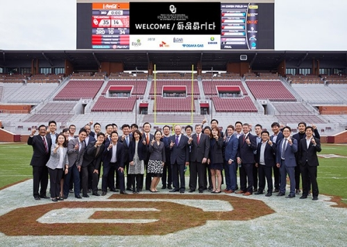 SK E&S group photo on OU Football field