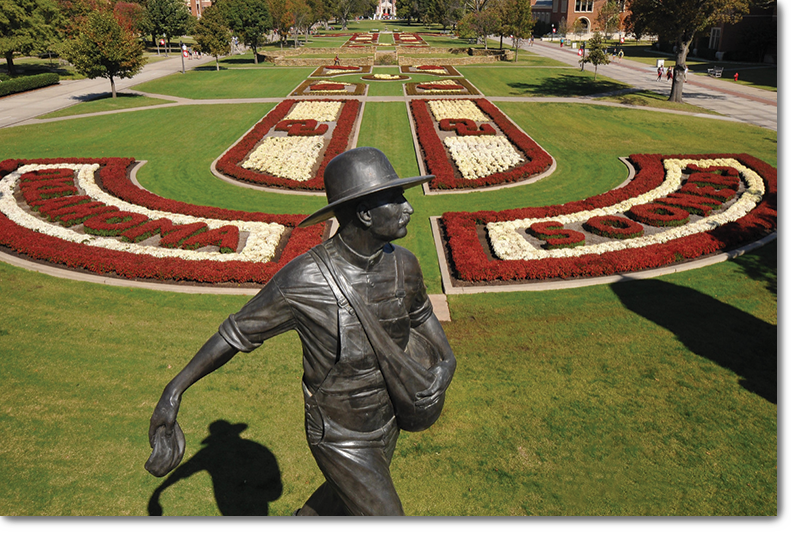 south oval; grass, flowers, and seed sower statue
