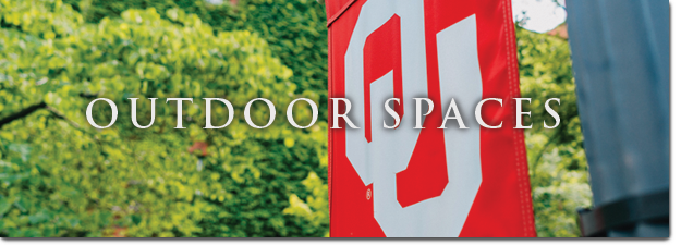 outdoor spaces text on top of leaves and red OU flag