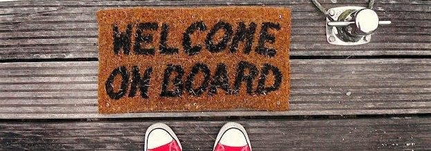 photo of welcome mat that says welcome on board