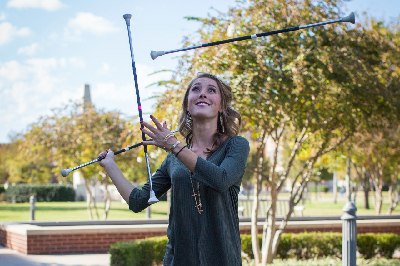 Sarah Harris, OU Twirler, with batons