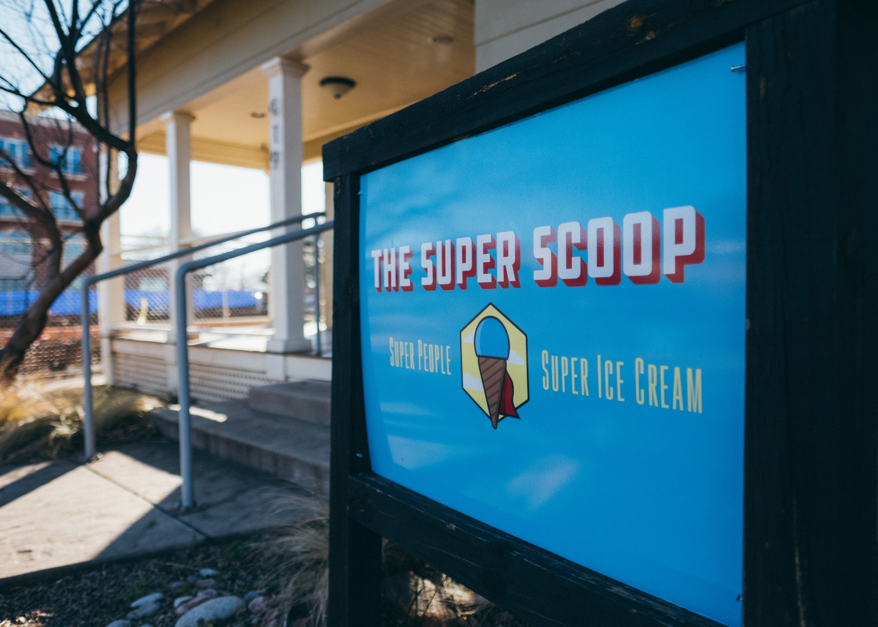 The Super Scoop's big blue sign in front of the store