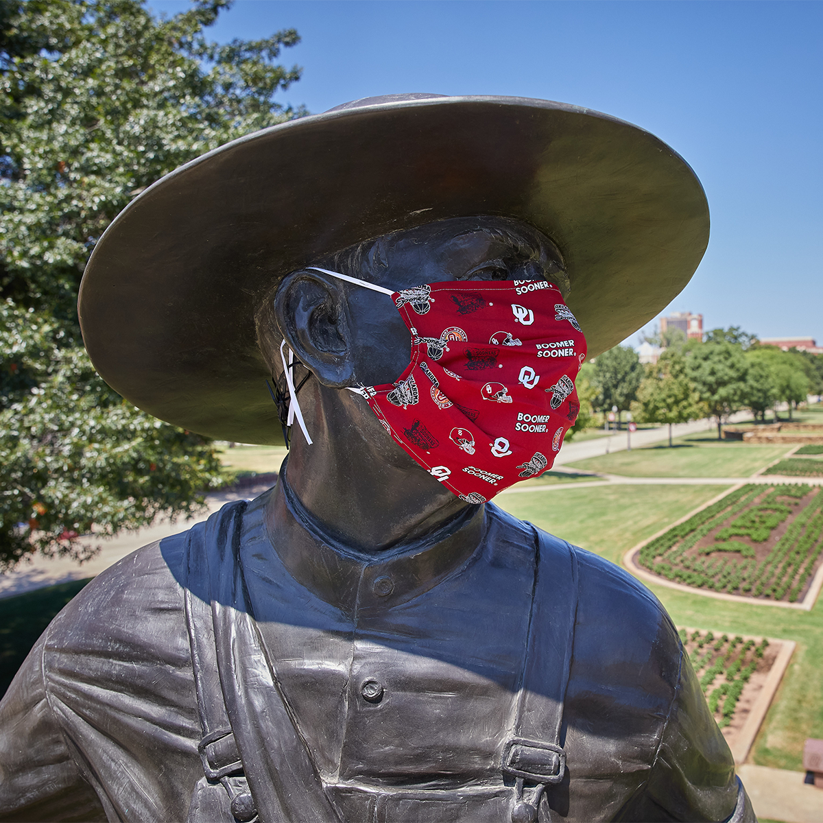 OU Seed Sower wearing a cloth mask