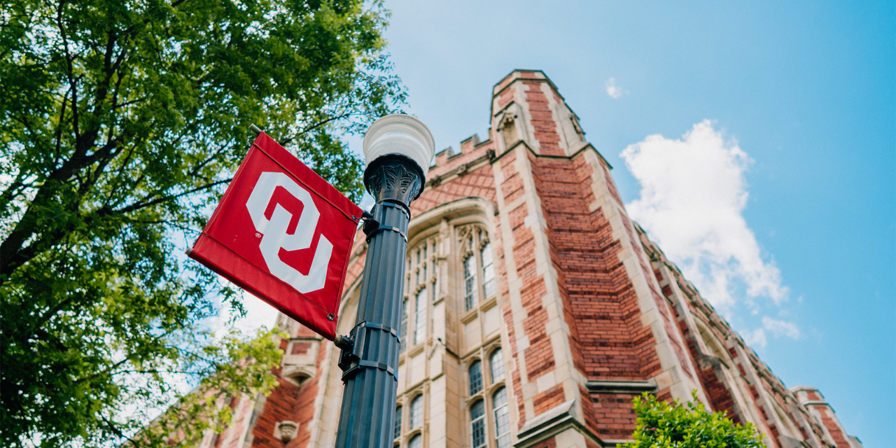 lightpost with OU flag outside Evans hall